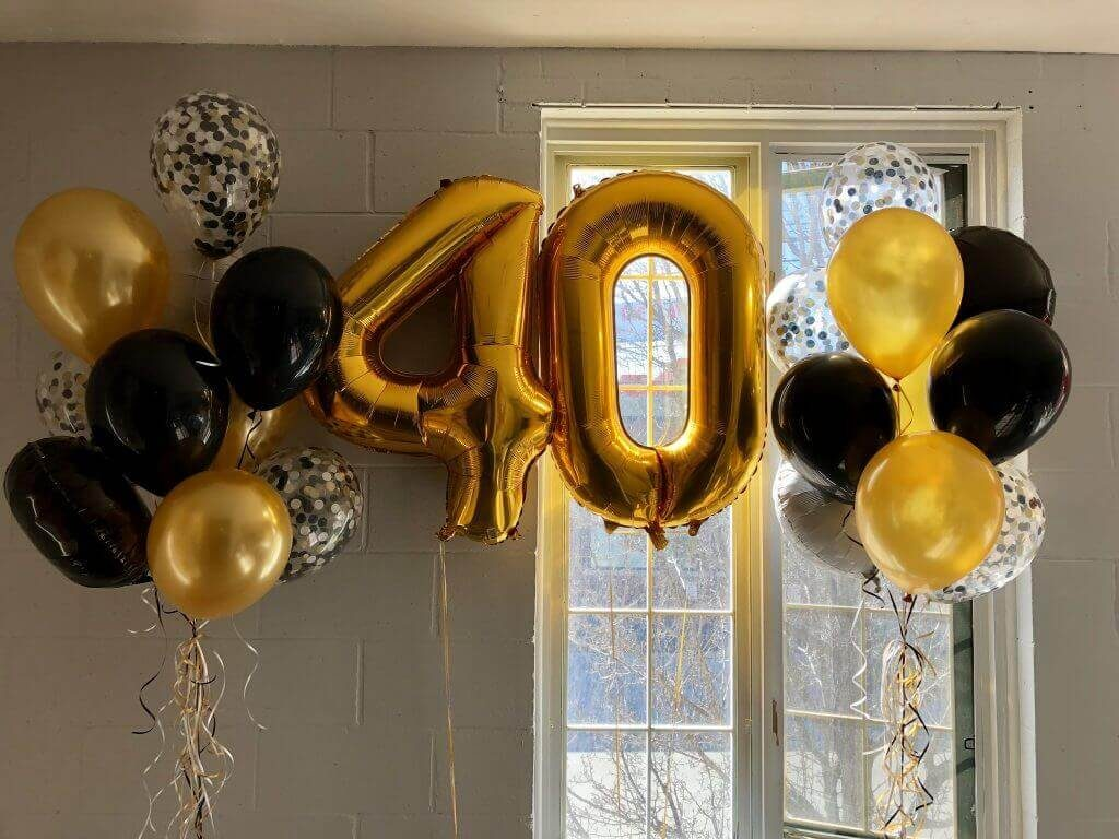 40th balloons gold foil with solid gold black and clear latex with black silver and gold confetti