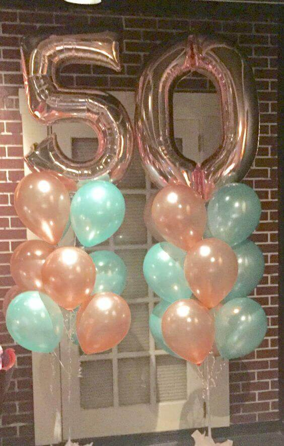 50th rose gold balloons column with mint green and rose gold latex balloons