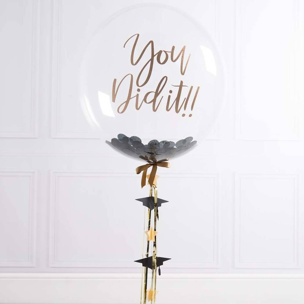 round clear graduation balloons with black confetti