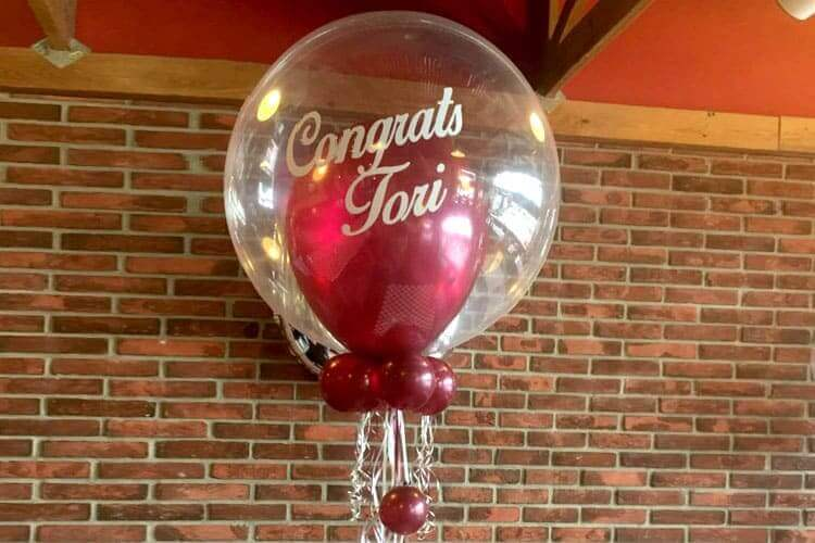 round clear burgundy graduation balloons with mini balloons inside