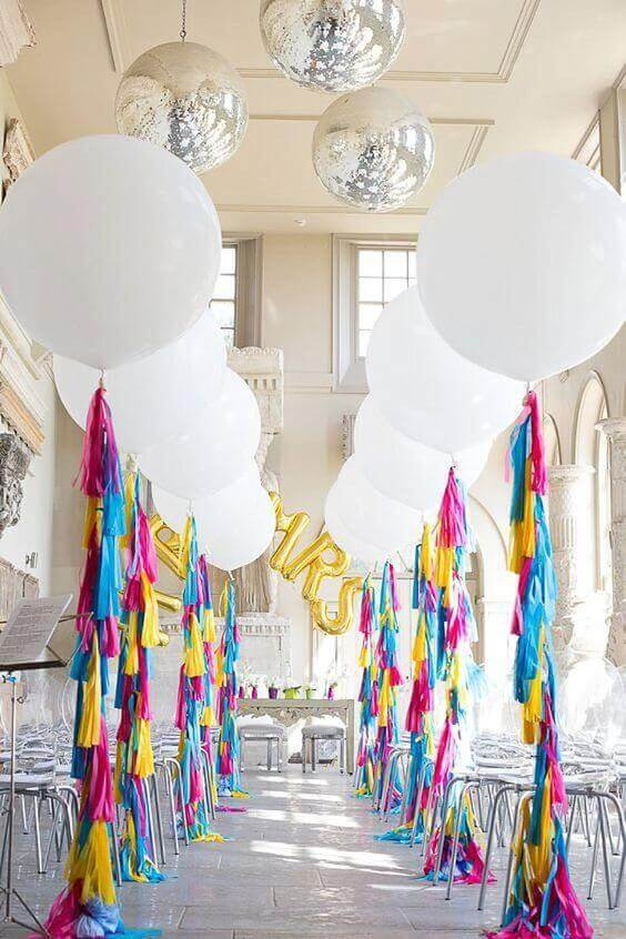 organic white round balloons on the colorful long tassel