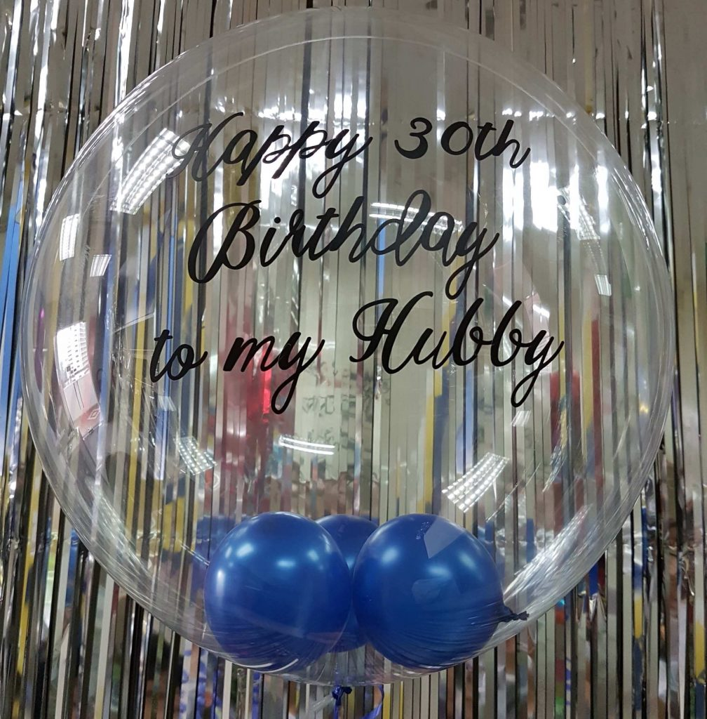 clear personalized bubble balloon with mini blue balloons inside