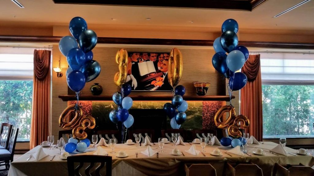 30th balloons table bouquet column with dark blue light blue and turquoise blue helium balloons
