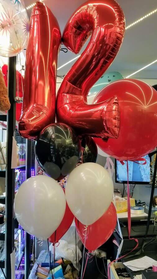 big foil number 12 red helium balloons with red black and white latex balloons