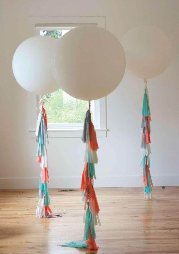 round jumbo white organic balloons with silver orange and teal tassel