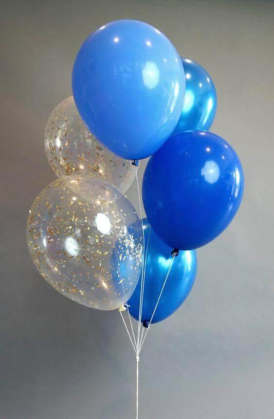 dark blue light blue and clear confetti balloon centerpiece
