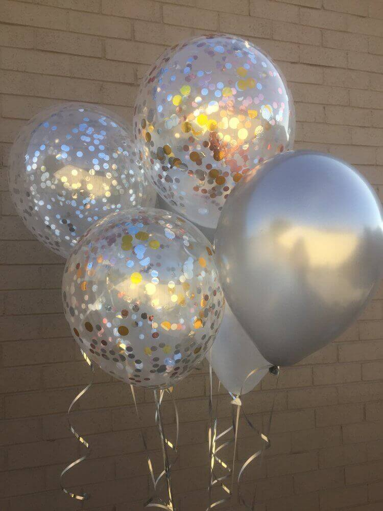 silver latex balloons centerpiece with clear confetti balloons and penalize white balloon