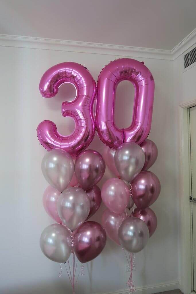 number 3 and 0 big number balloons with pink and silver latex balloons