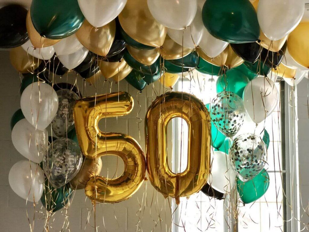 golden 50th big number balloons with ceiling latex confetti white gold and green balloons
