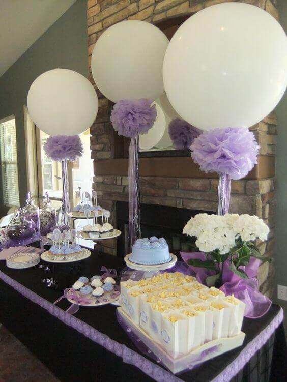 big round white balloons with lavender for the candy table birthday christening or anniversary