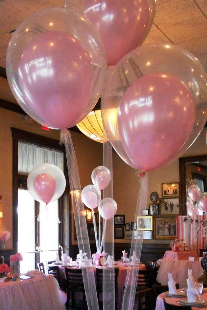 pink helium latex balloon in big clear latex balloon with tulle strings