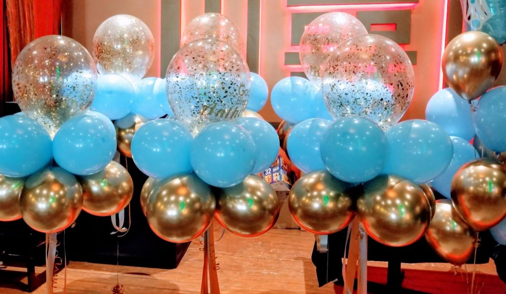 golden and light blue balloons