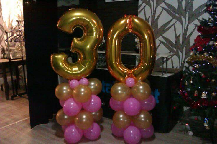 helium hot pink and gold balloons on balloons column