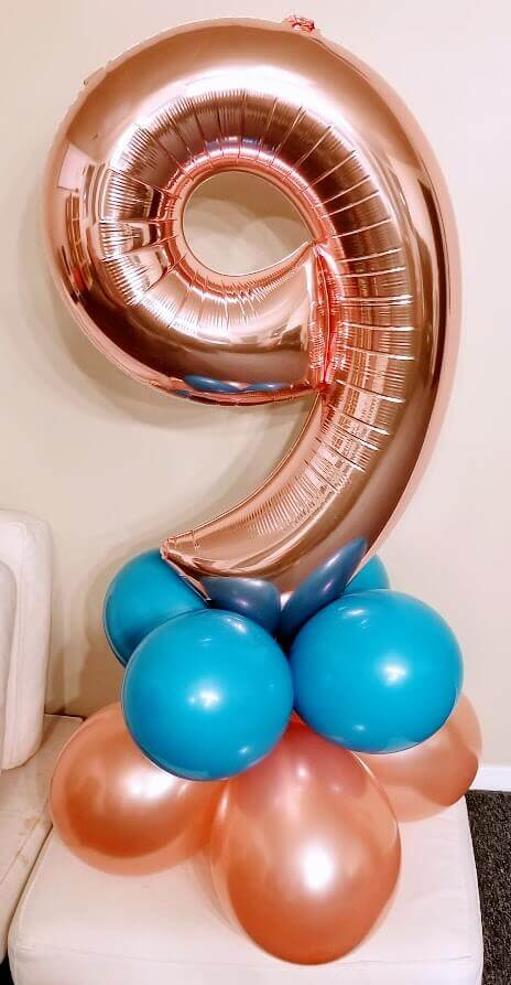 rose gold number 9 balloons centerpiece