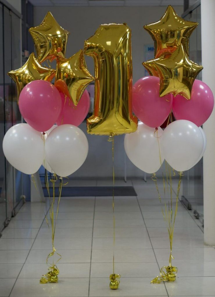 big number 1 in gold with pink and white latex balloons