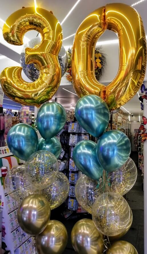30th birthday balloons centerpieces in gold metallic green and confetti balloons