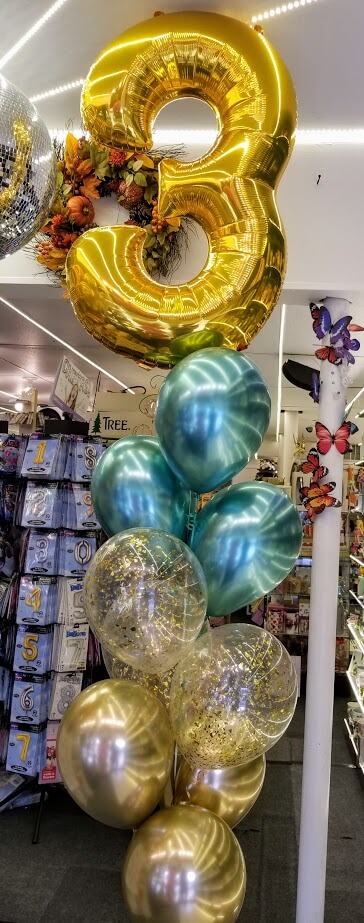3rd birthday balloons centerpieces in gold metallic green and confetti balloons