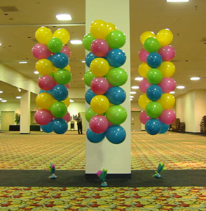 birthday floating neon balloons column with a balloon weight