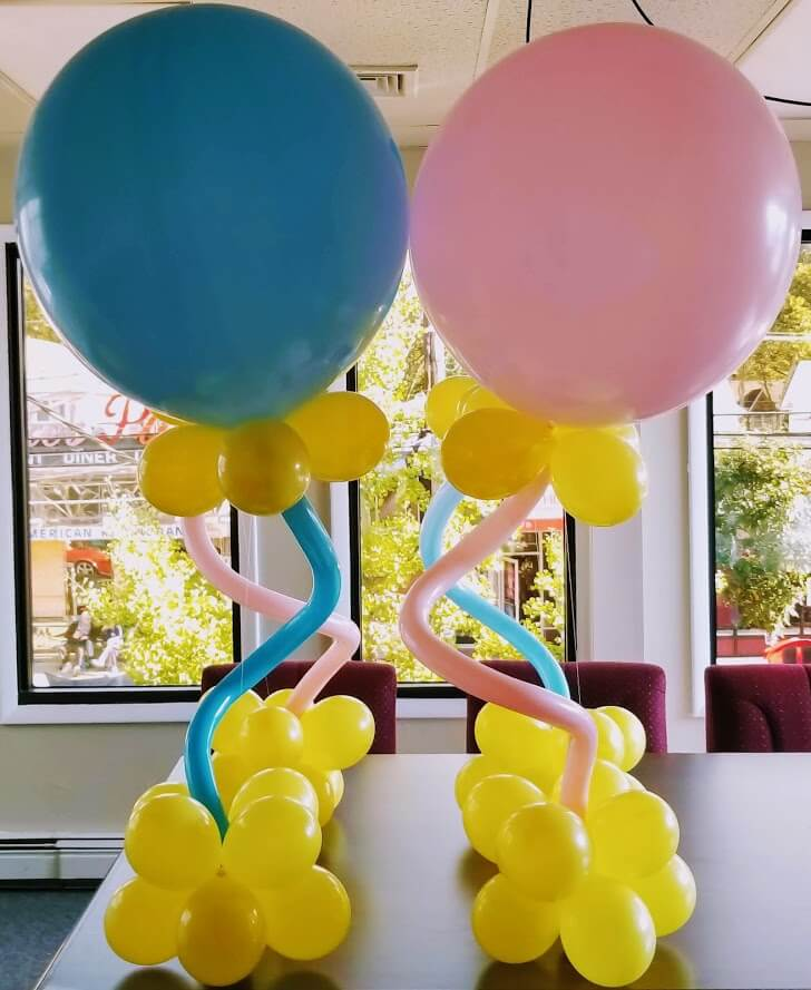 baby shower jumbo balloons in pink and yellow colors