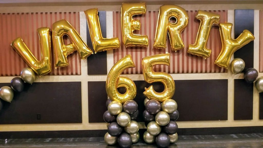 balloons name arch and 65th birthday number in brown and gold chrome