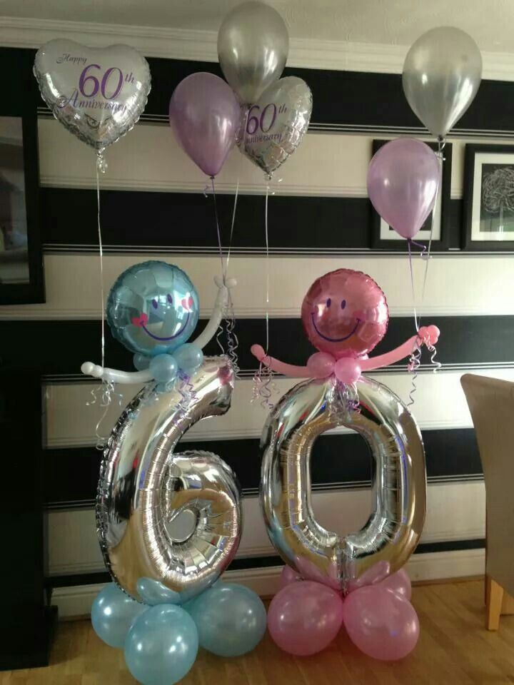 big silver 60th balloons with smiley face balloons with pink and blue latex