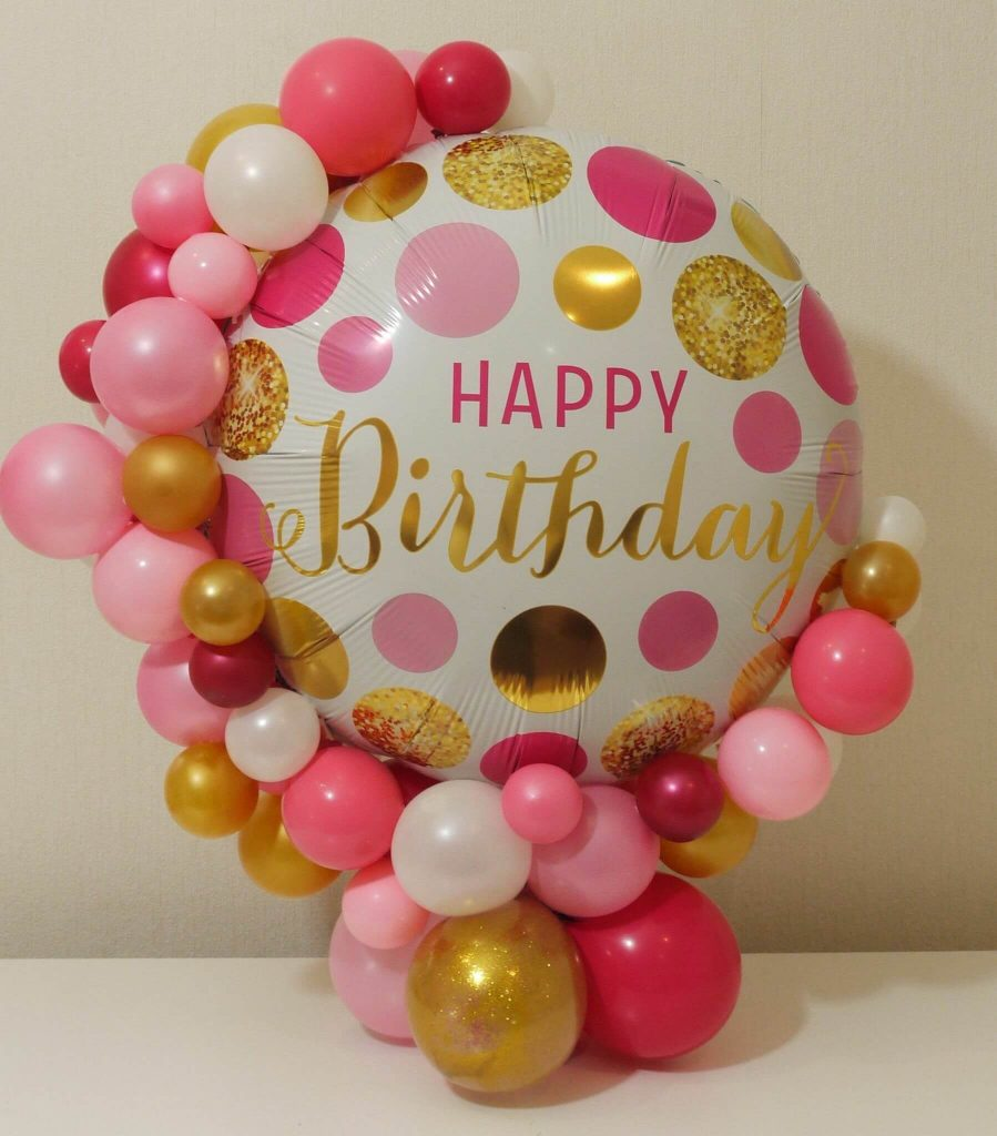 big mylar birthday balloon with mix pink latex balloons garland around for girl