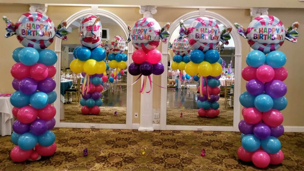 candy theme balloons arch and columns for birthday