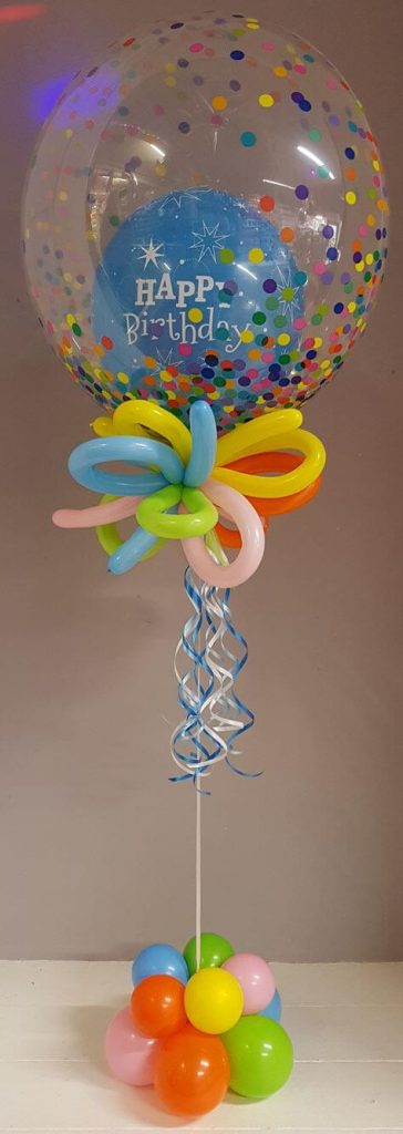 clear balloon with colorful polka dot and insider balloon birthday centerpiece
