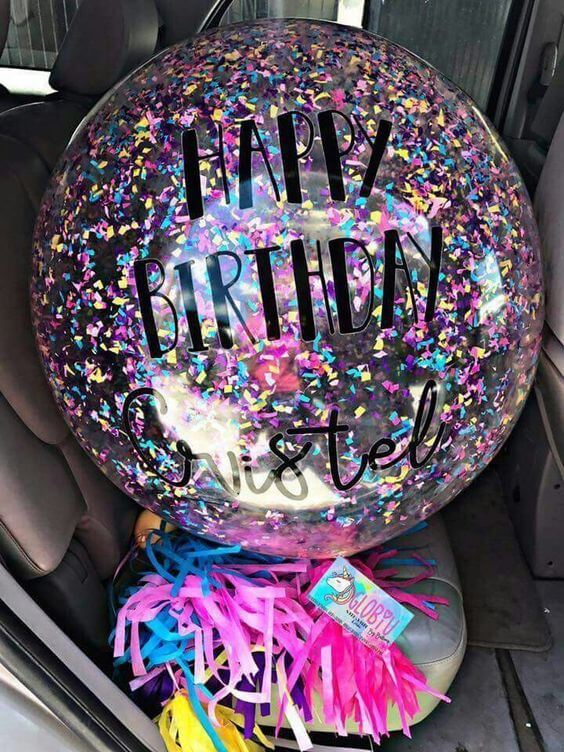 a big round clear mix colors confetti balloon with fringes tassel