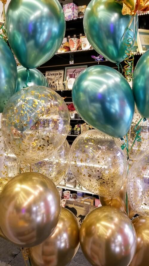 chrome green and a gold balloon with clear gold confetti bridal shower balloons