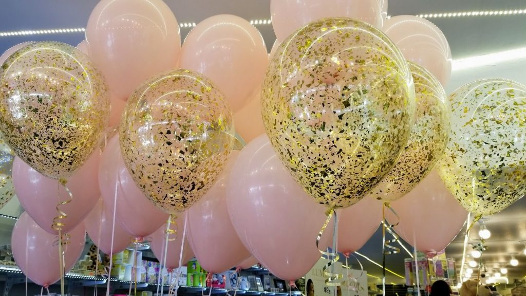 gold confetti clear balloons and pink latex balloons for a girl christening