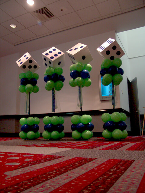green and blue dice shape birthday balloons columns