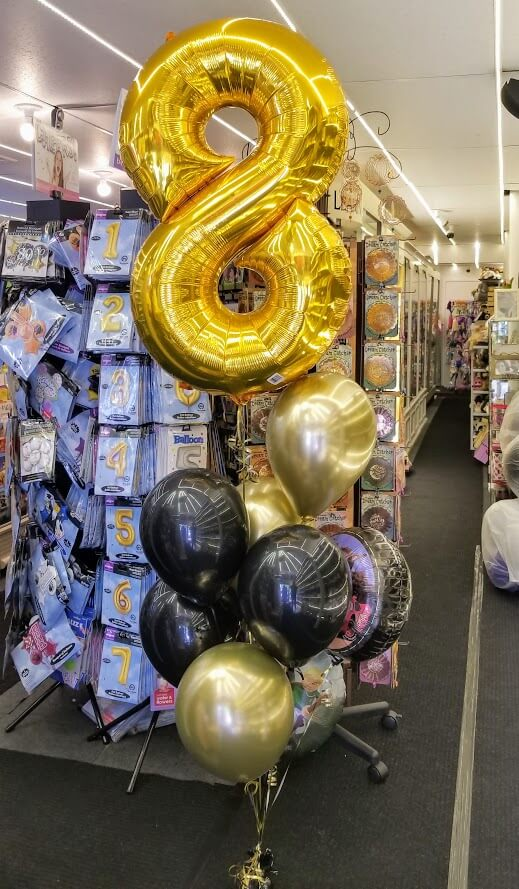 big number 8 balloons centerpiece with chrome gold and black latex balloons for birthday or anniversary