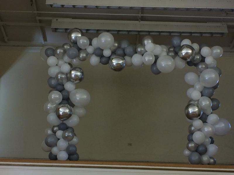 chrome silver balloons arch with white and gray latex balloons