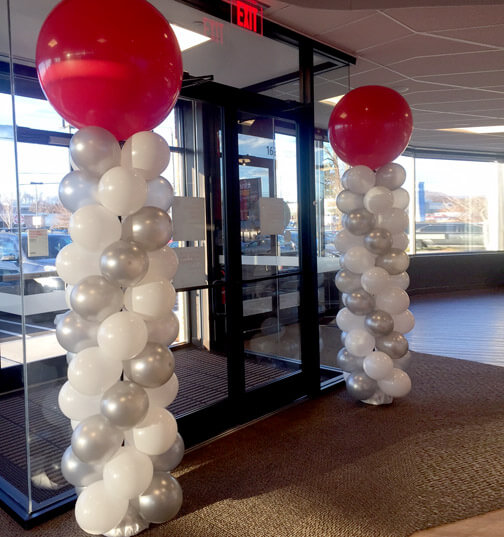 red silver and white balloons column