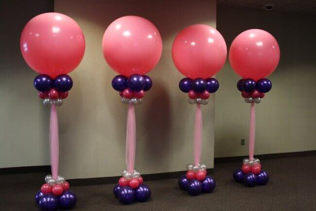 pink round balloons columns for a christening with mini chrome balloons