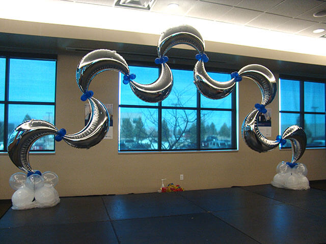 silver Mylar birthday moon balloons arch unique style with mini blue balloons