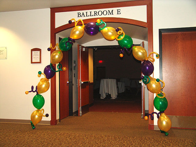 gold green and purple single balloons arch for any party room entrance