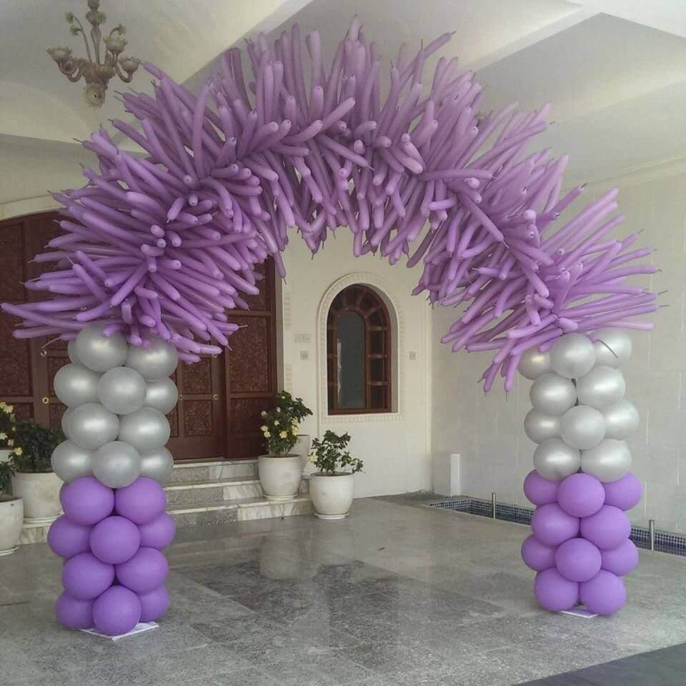 lavender ​and silver ​tube balloons arch