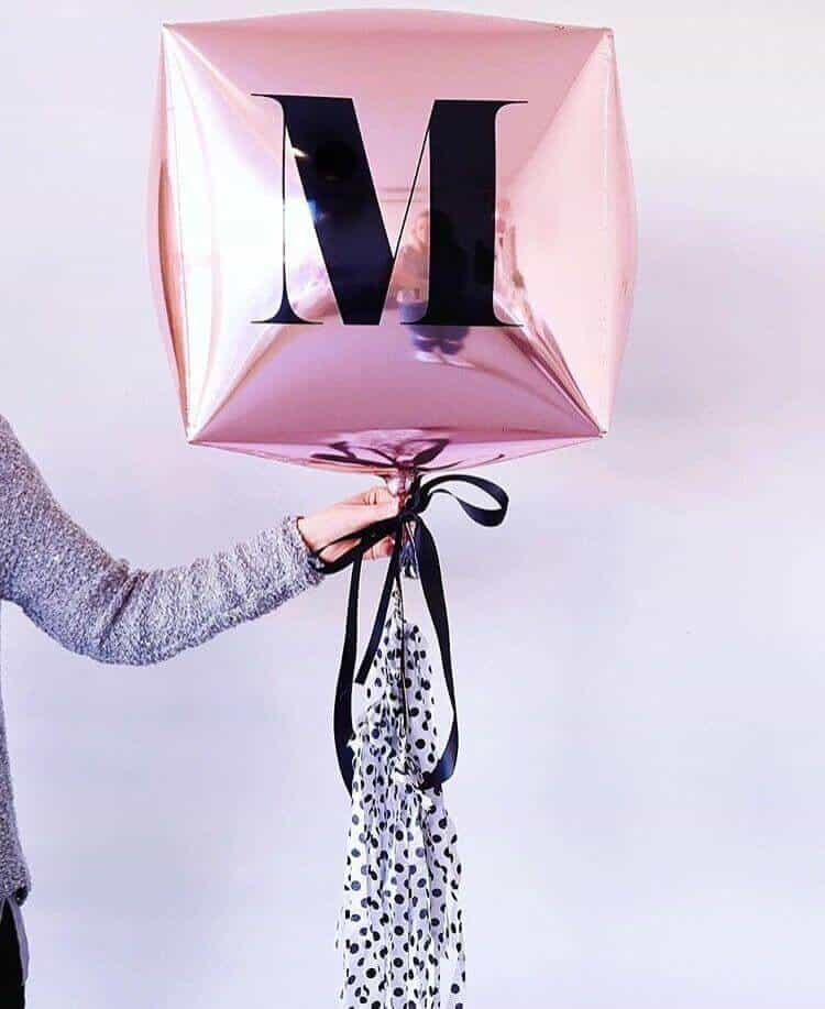 pink Mylar tassel letter balloons