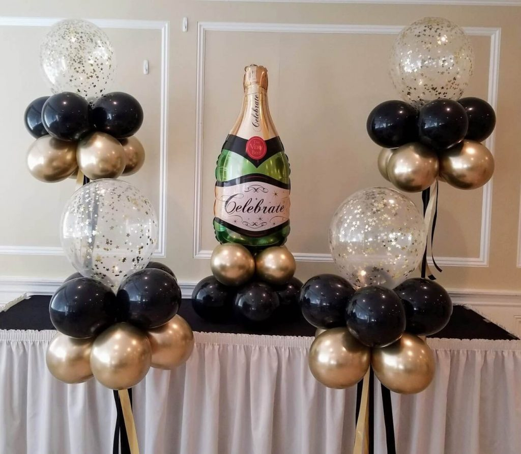 Hollywood theme birthday balloons in gold black and gold confetti balloon with champagne bottle