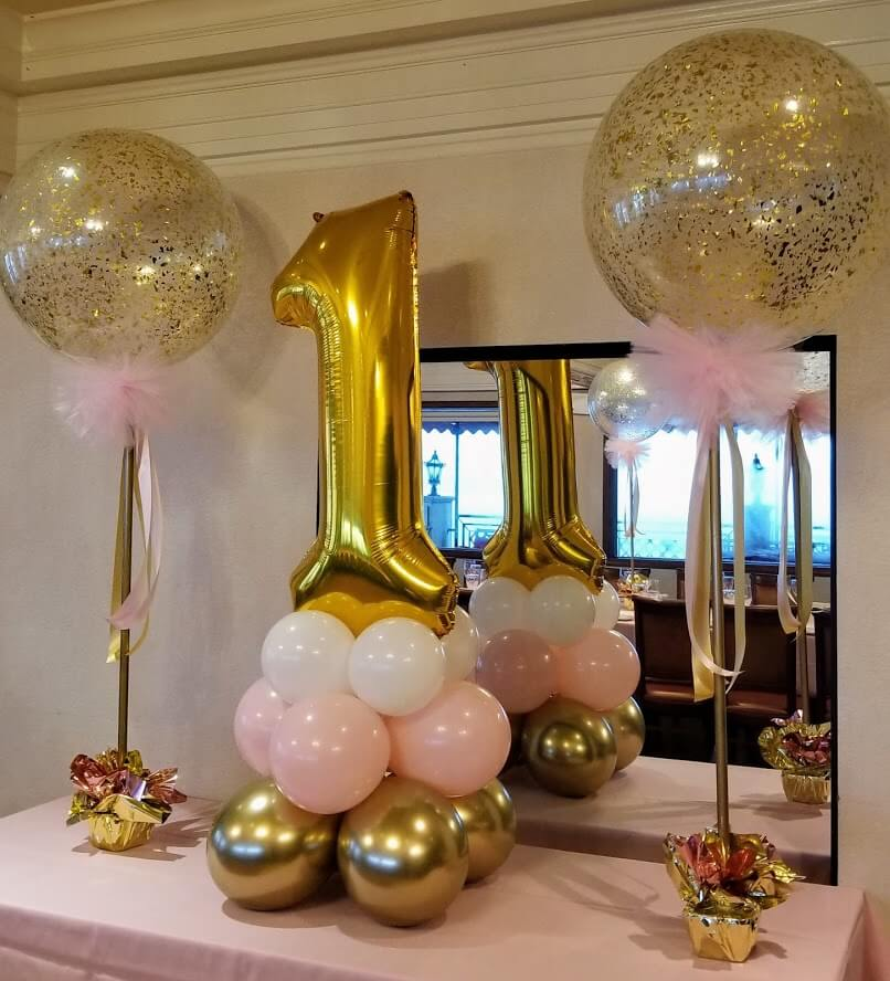 one year balloons set for table in pink and gold balloons