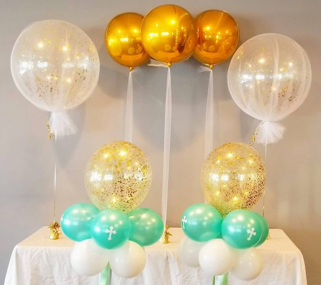 first birthday balloons decoration for candy table with tulle balloon and gold orbz balloon