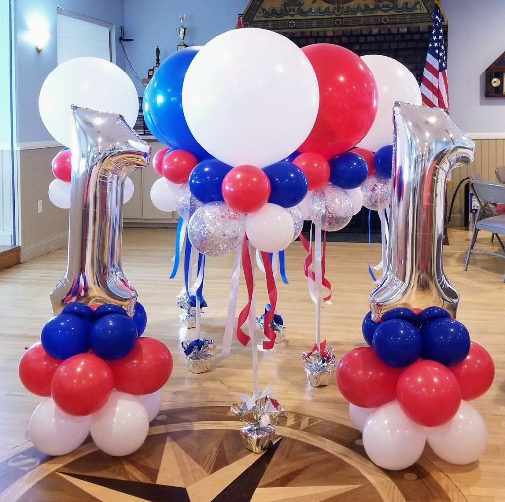 big round balloons centerpiece with big number one silver balloon