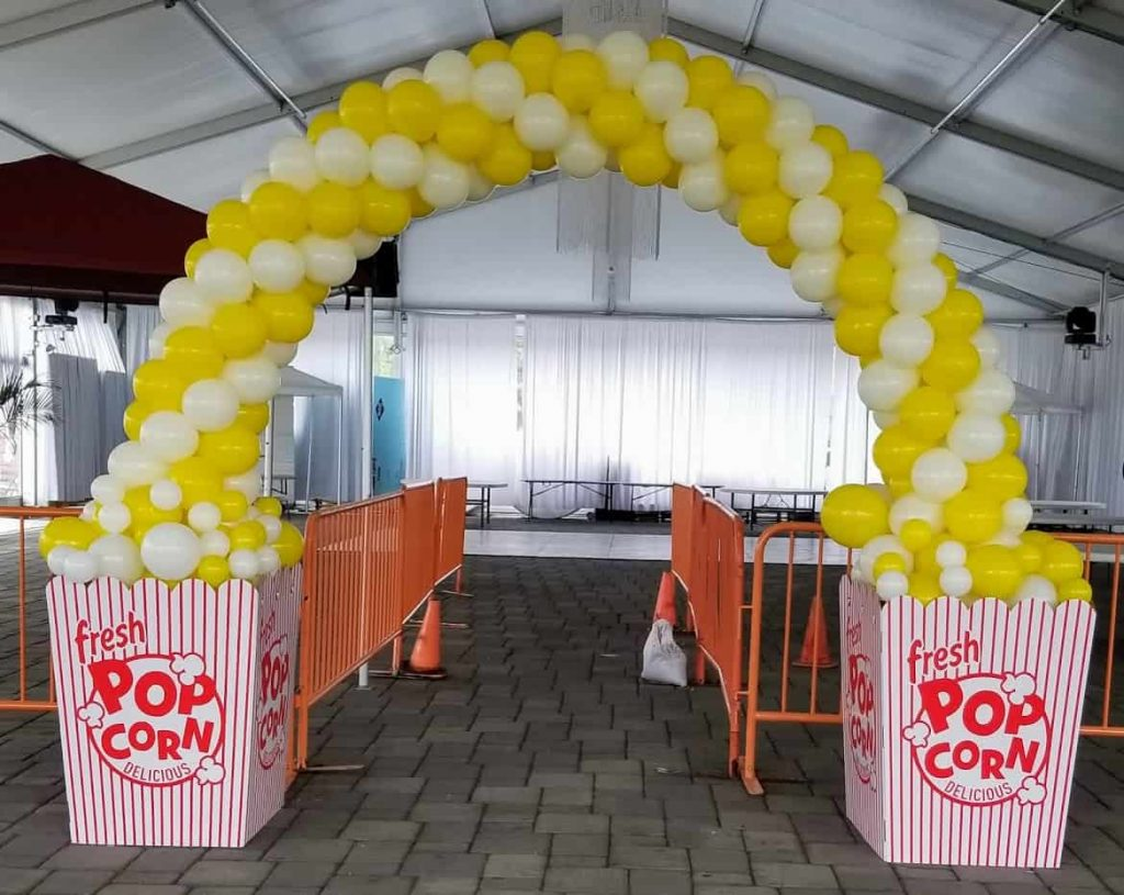 yellow and white popcorn balloons arch