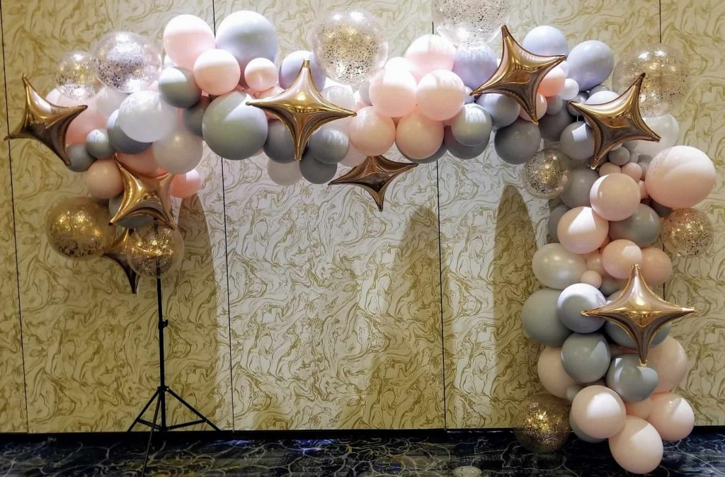 baby first birthday balloons garland arch in pastel colors