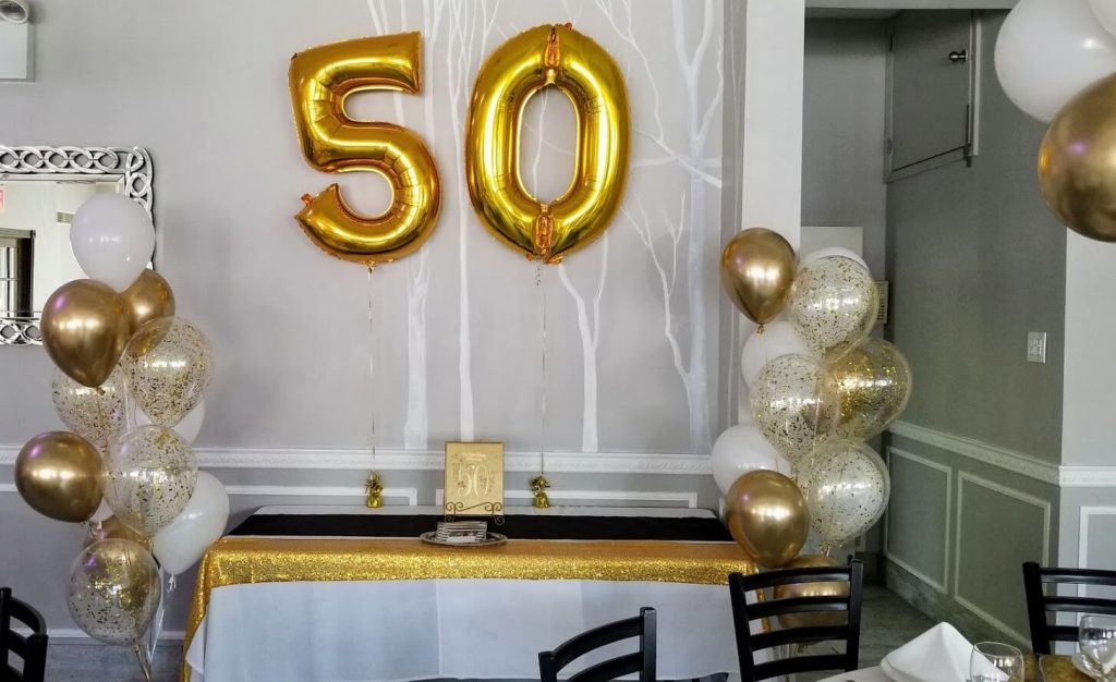 big Mylar 50 balloon with gold and white latex balloons for 50th birthday