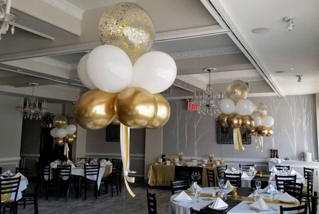 gold and white anniversary balloons