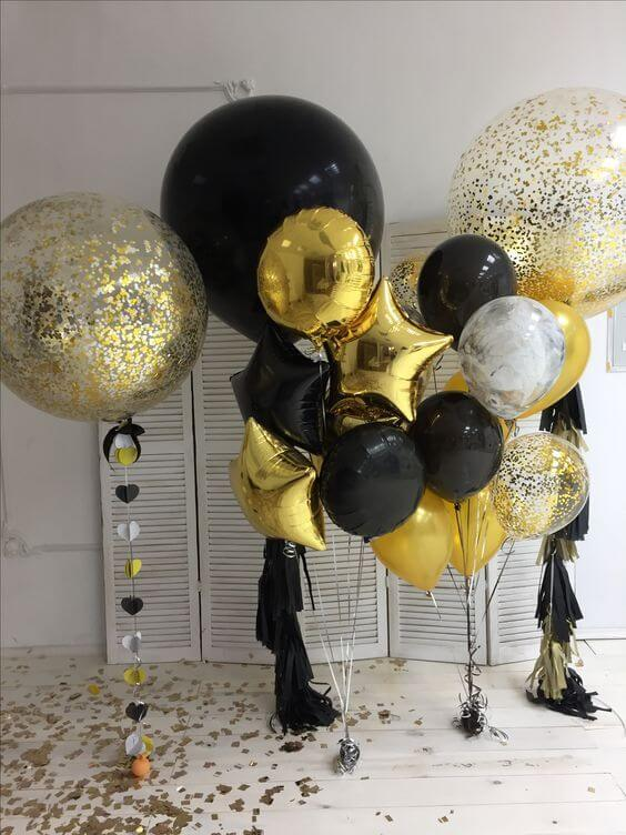 big round black and gold confetti balloons with gold mylar star balloons for birthday New York