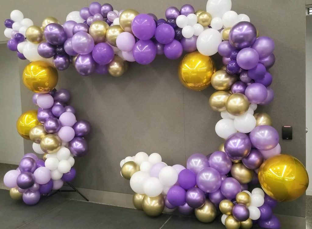 balloons garland arch in purple lavender gold and white balloons for corporate event